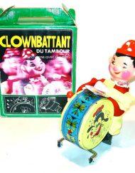 Vintage drumming clown toy