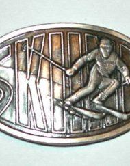 Skiing belt buckle