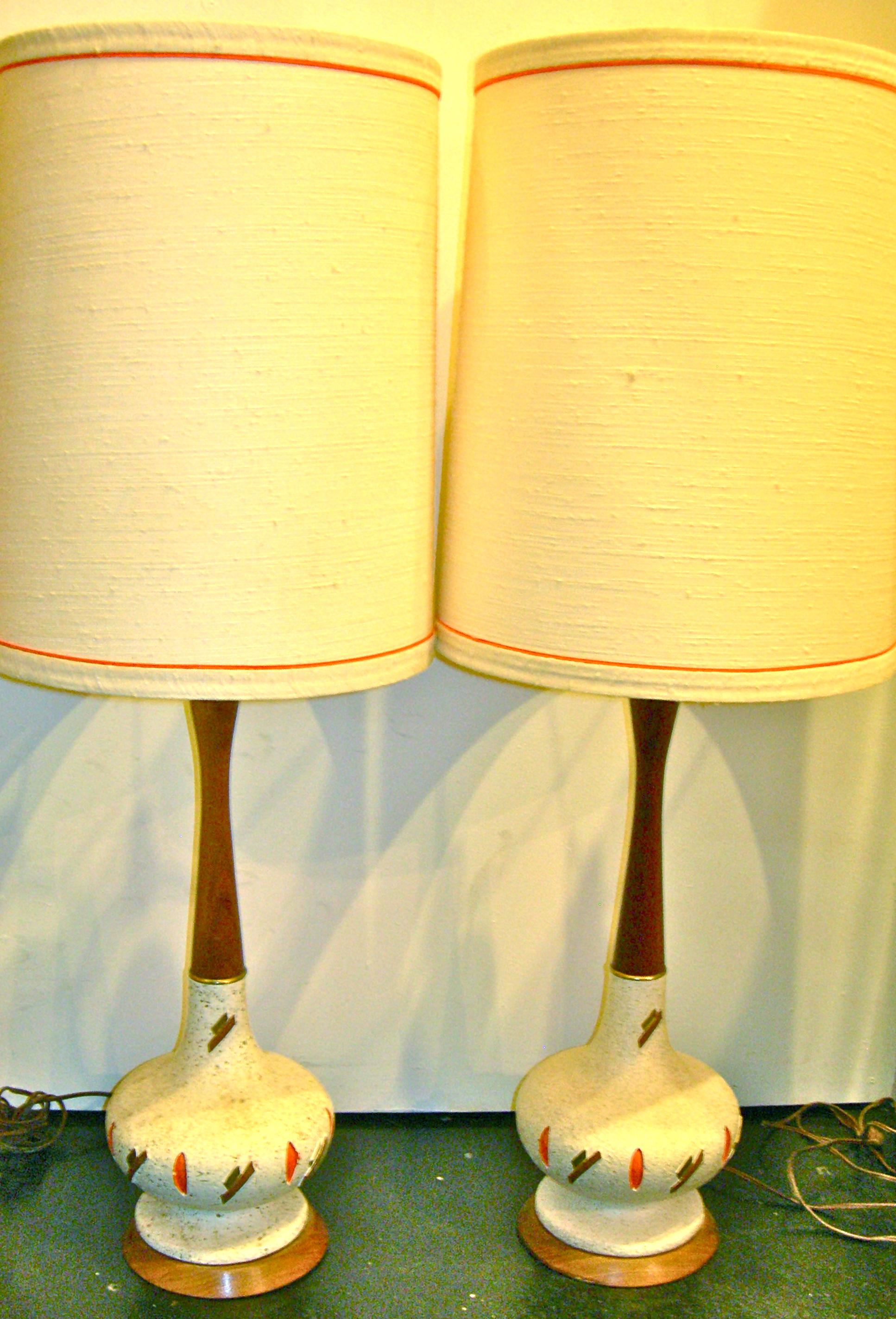 Pair of vintage ceramic base lamps with orange & brown shapes