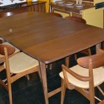 Vintage Danish modern style dining set with 6 chairs, 2 leaves, and drop-down wings for a more compact footprint, PLUS original table pads