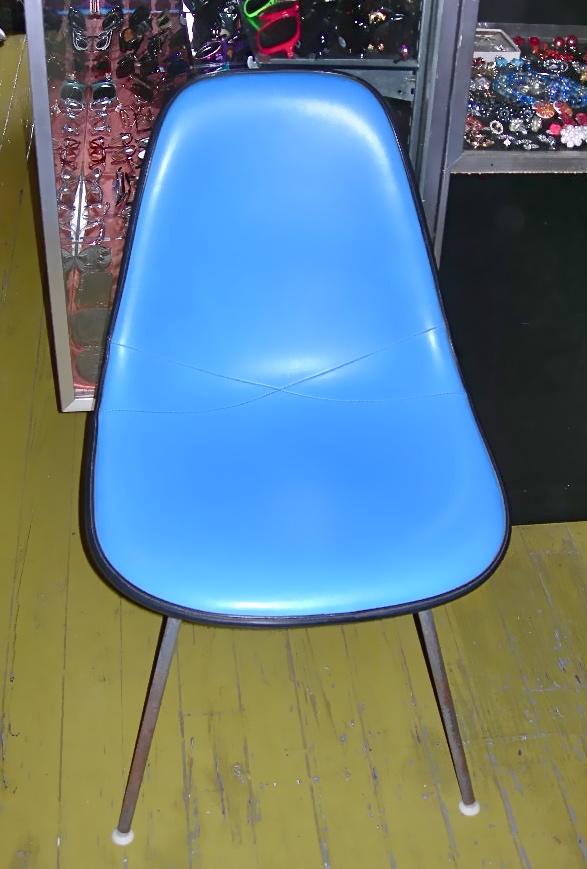 Herman Miller blue vinyl upholstered chair w/black trim, SOLD
