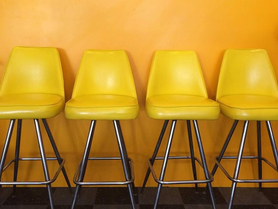Set of 4 yellow vinyl upholstered swivel bar stools, SOLD