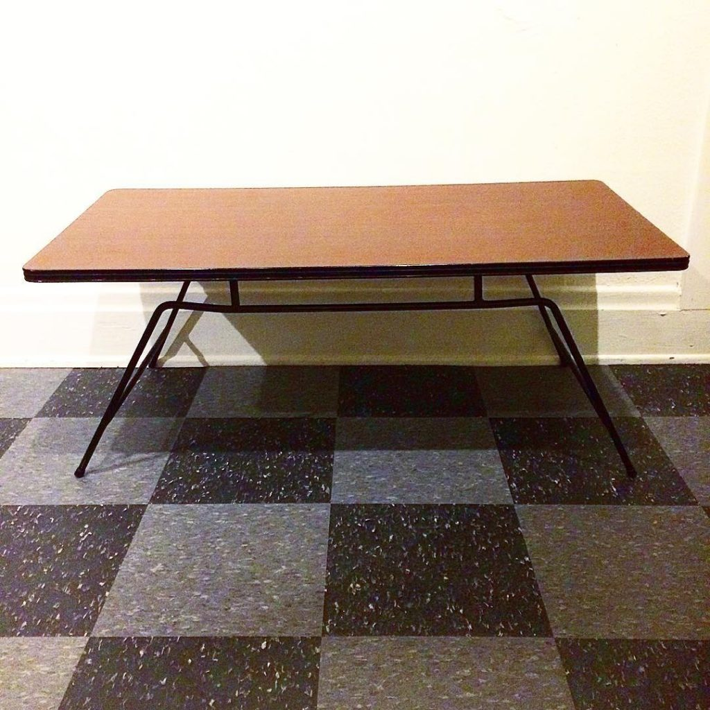 Vintage coffee table by Clifford Pascoe, laminate surface and iron frame, $150