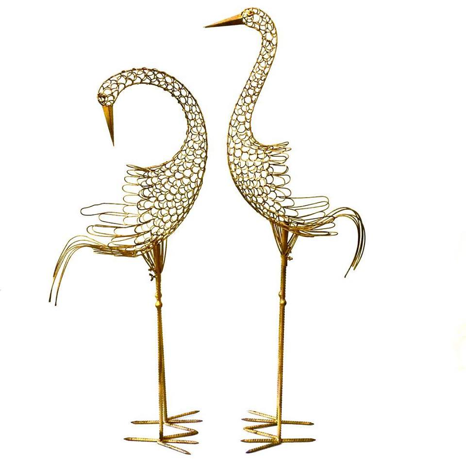 Pair of featherless steel peacocks
