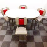 Howell chrome frame and speckled gray Formica top table, and 4 Kuehne chrome frame chairs that have red and gray vinyl upholstery, SOLD